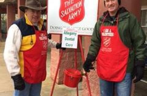 Dr. Smith and Dr. McCafferty ringing the bell for the Salvation Army.
